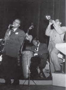 L to R: James Moody, Chano Pozo, and Dizzy Gillespie, circa 1948.